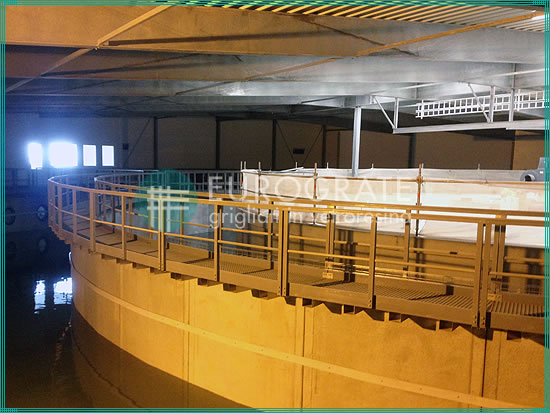 walkways with gratings and safety handrails installed in a tank in the fishing industry