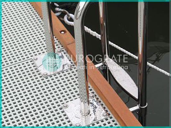grated paving and access ladders for getting on and off a boat moored in a harbour