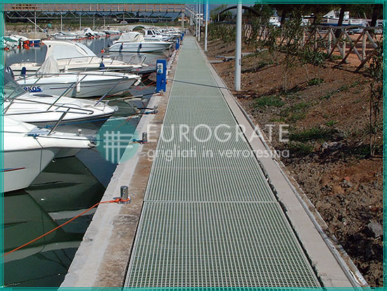 grated walkway installed in a coastal location with yacht moorings