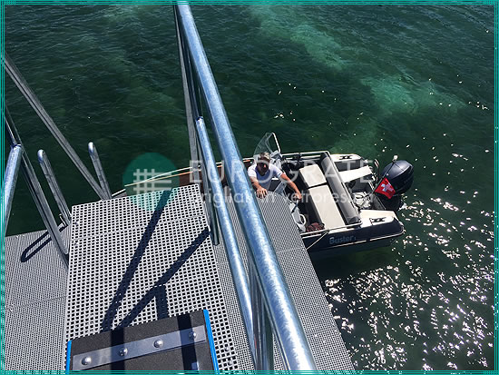 vertical ladders and grating walkways make it safe and easy to get on and off a boat