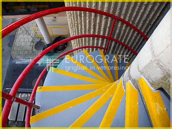 Stair tread covers used on a concrete spiral staircase