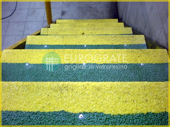 Green and yellow coloured stair tread covers to make steps visible in low light levels