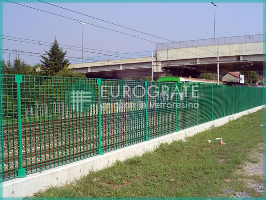 railing constructed of fencing panels for passing trains