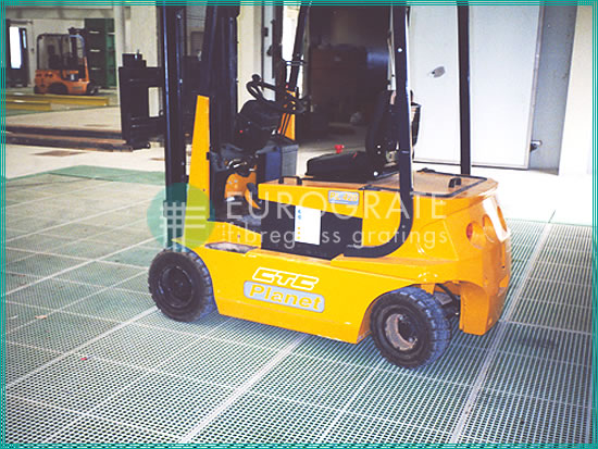 electric forklift truck working on a grated floor