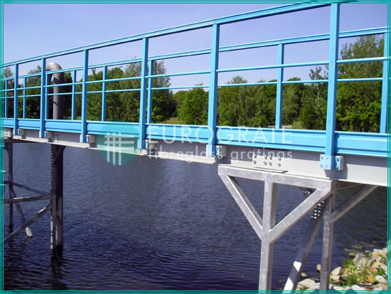 bridge with handrails in the basin of a water treatment plant